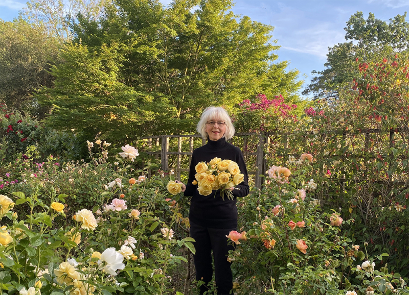 Carolyn Parker holding yellow roses