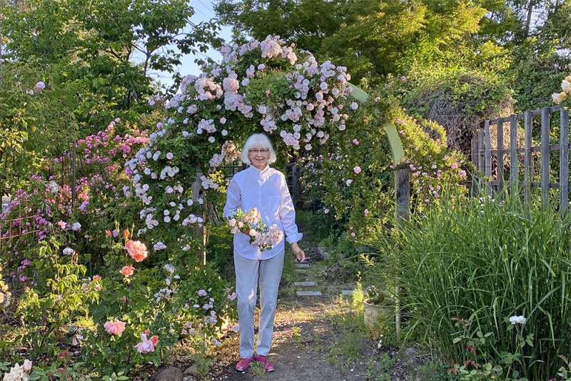 Carolyn Parker Under Rose Arch in Her Garden
